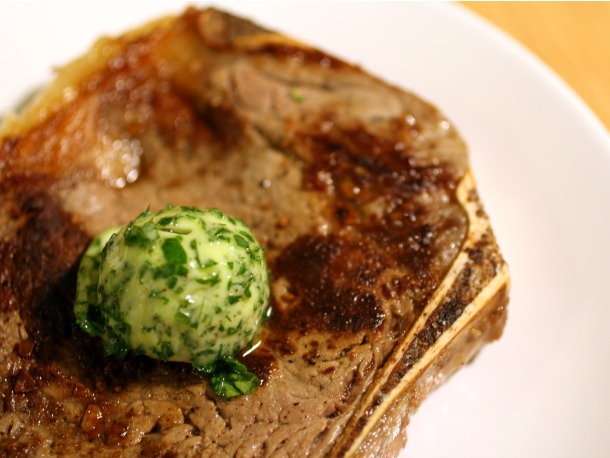 Beurre Maître d'Hôtel, stuffed with parsley, on a juicy, charred sirloin steak