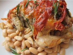 Hens with Prosciutto, Rosemary, and White Beans